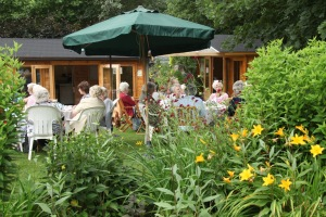 Group enjoying outdoor refreshments outside the tea room